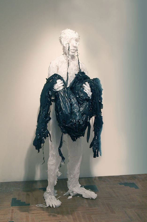 """Collector,"" black and white trash bags"