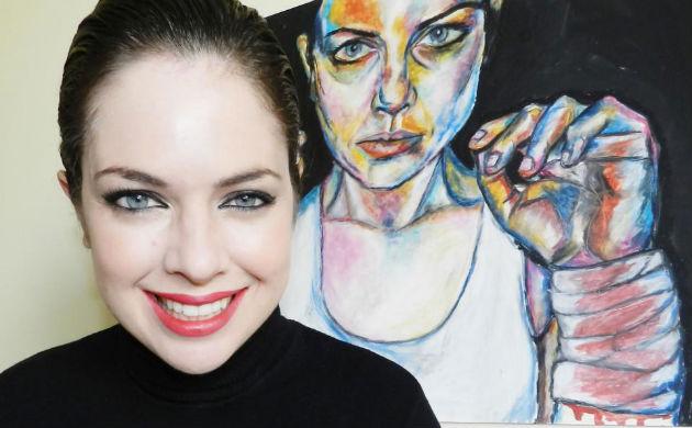 April Mansilla with artwork