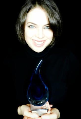 April Mansilla with award